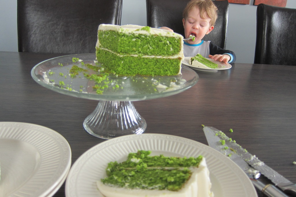 The Delightful Lime Cake with Ginger Cream Cheese Icing is a perfect St. Patrick's Day cake!  Check out Max in the background, he is obviously loving this cake and oblivious to the fact that he is eating a lot of spinach!
