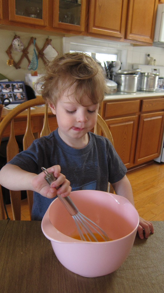 Max helped me beat the eggs for his cake.