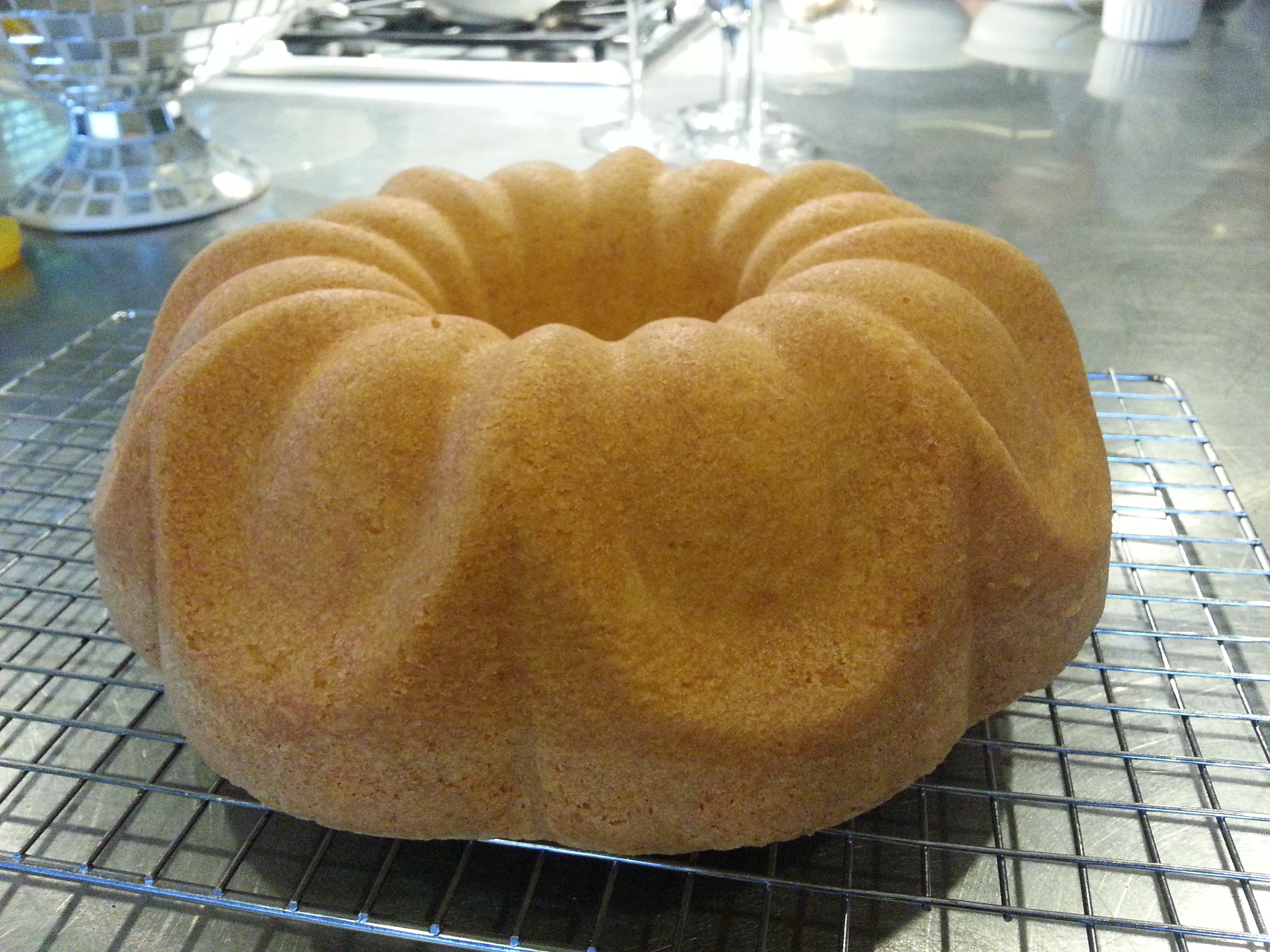 A well buttered and floured bundt pan turned out this beautiful Sour Cream Pound Cake.