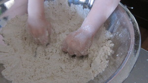 Max helped me combine the cold butter into the spelt flour mixture.