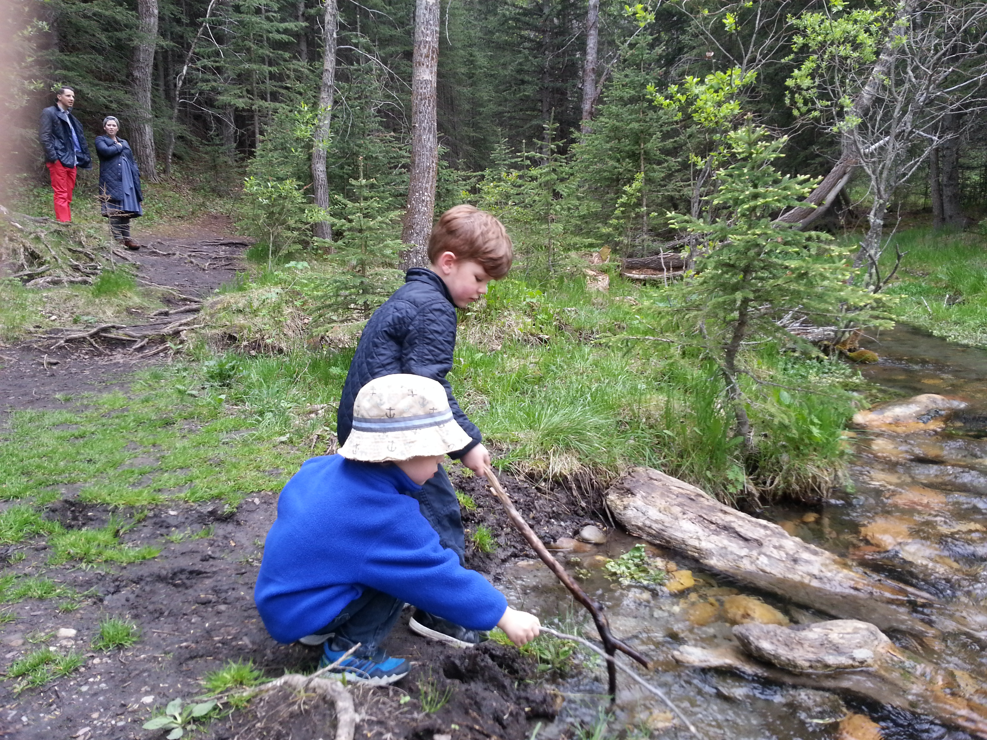 Max and Vinnie stopped whenever they could to find a twig or rock to throw.  This time they decided they needed to go fishing.