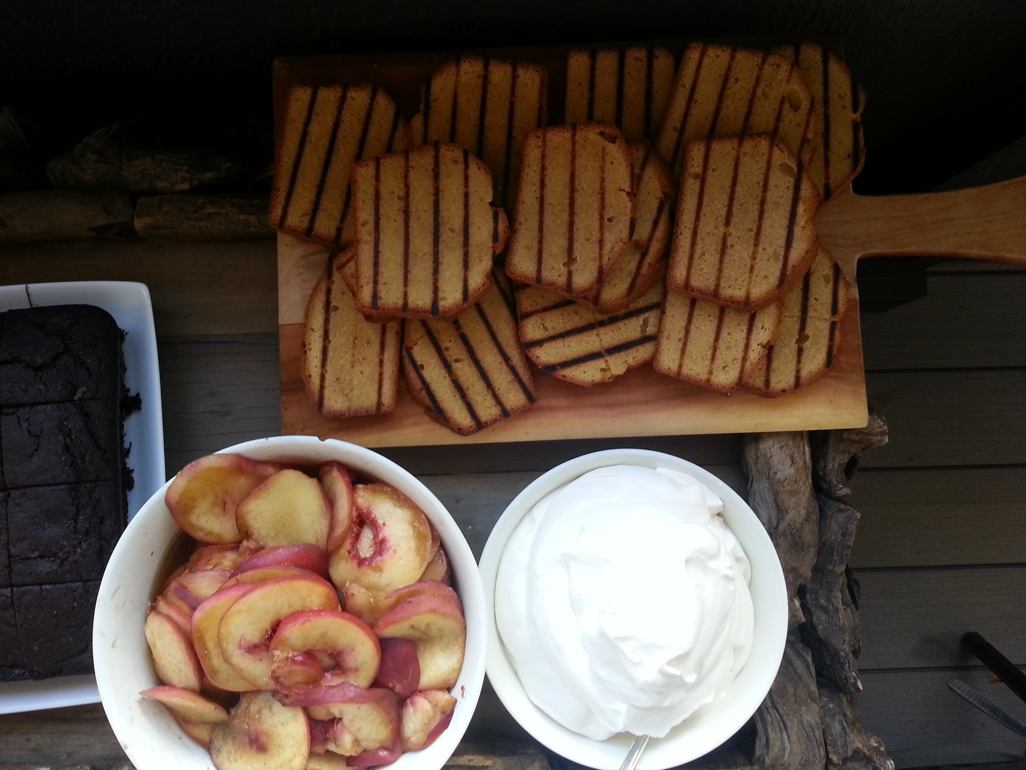 Slices of Browned-Butter Brown Sugar Pound Cake grilled and served with Maple-Cardamom Peaches and Whipped Cream.  Heavenly!