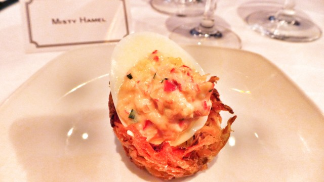 Amuse Bouche of Truffled Lobster Egg in a Rosti Nest.