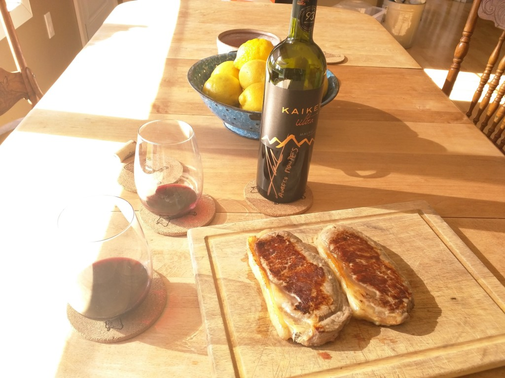 Grassfed beef steaks resting, Kaiken wine opening nicley...warming up to a perfect beef tasting!