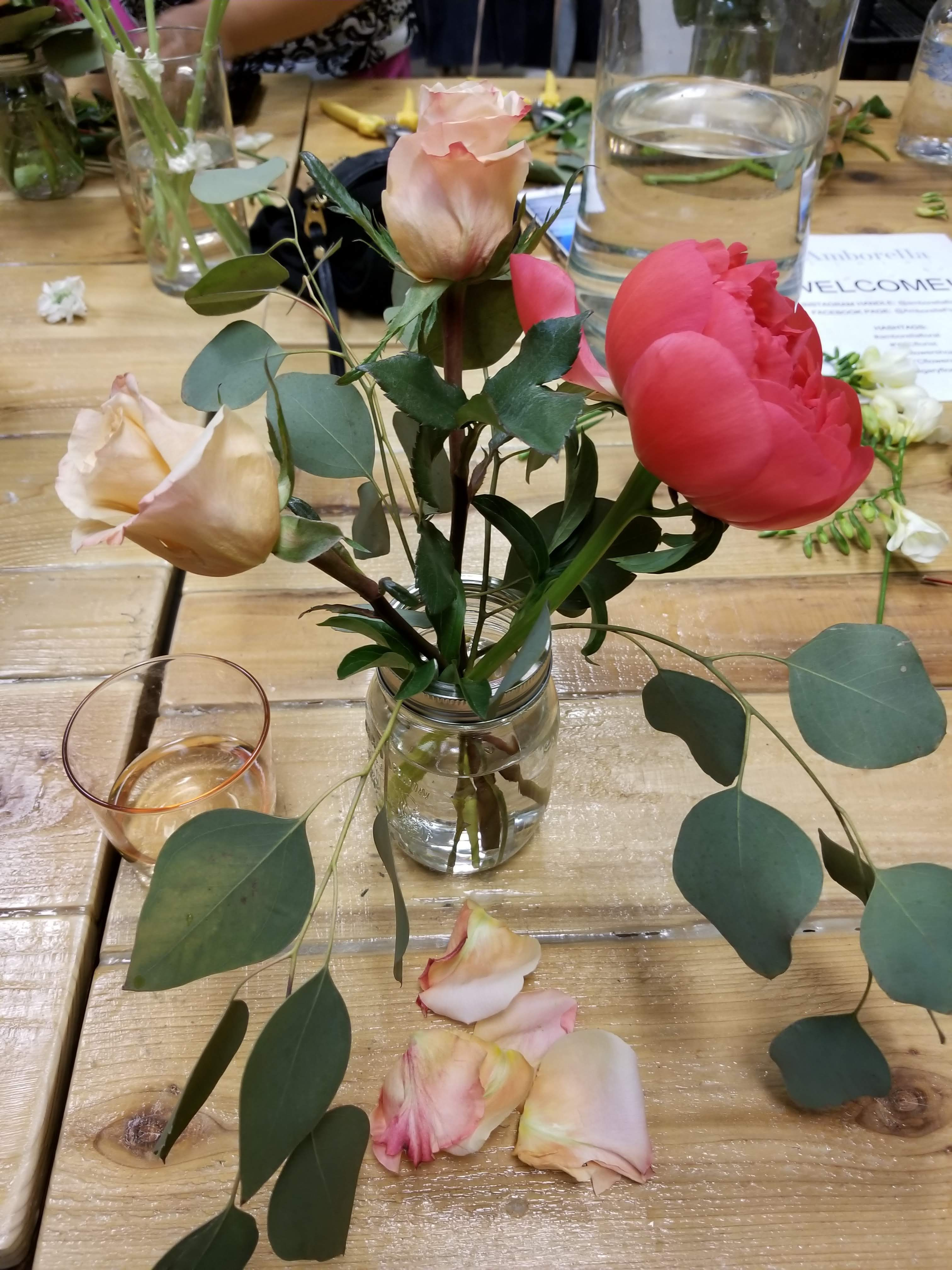 Roses were the second flowers that we added to our bouquets. We trimmed off leaves that would be lower than the water level and also took off the outer layer of petals to keep the rose looking fresh.