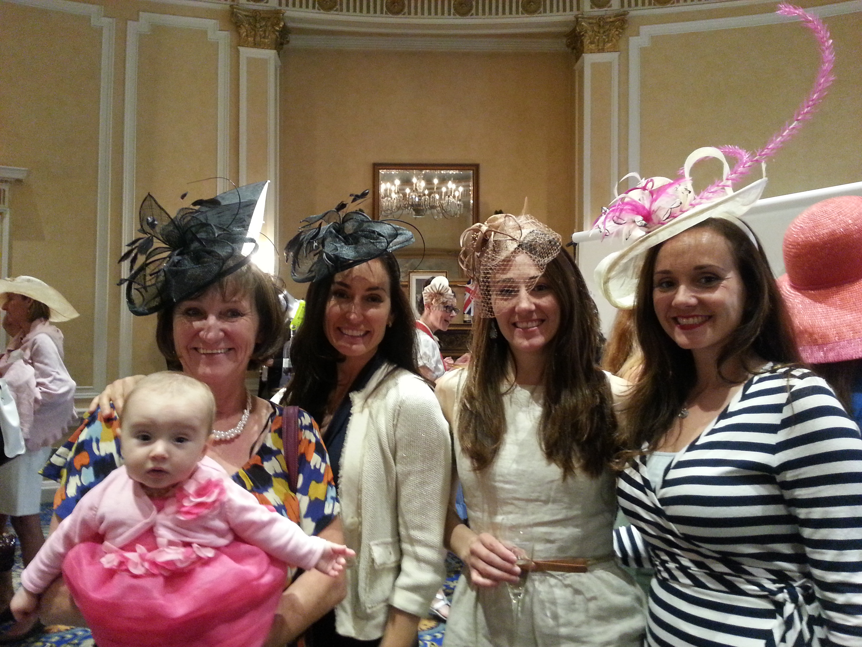 This gorgeous family caught my eye at the tea party.  They all looked fantastic in their fascinators! Most of these fascinators can be found at Chapel Hats at Chinook Center in Calgary.
